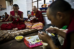 INDIA - Life in Exile (Tibetan Refugees) <br /> Monks eat meal at Reception Center, a temporary shelter for newly arrived Tibetan refugees in McLeod Ganj, Dharamsala, India, where the Dalai Lama settled after fleeing Tibet in 1959 after a failed uprising against Chinese rule, May 29, 2009.