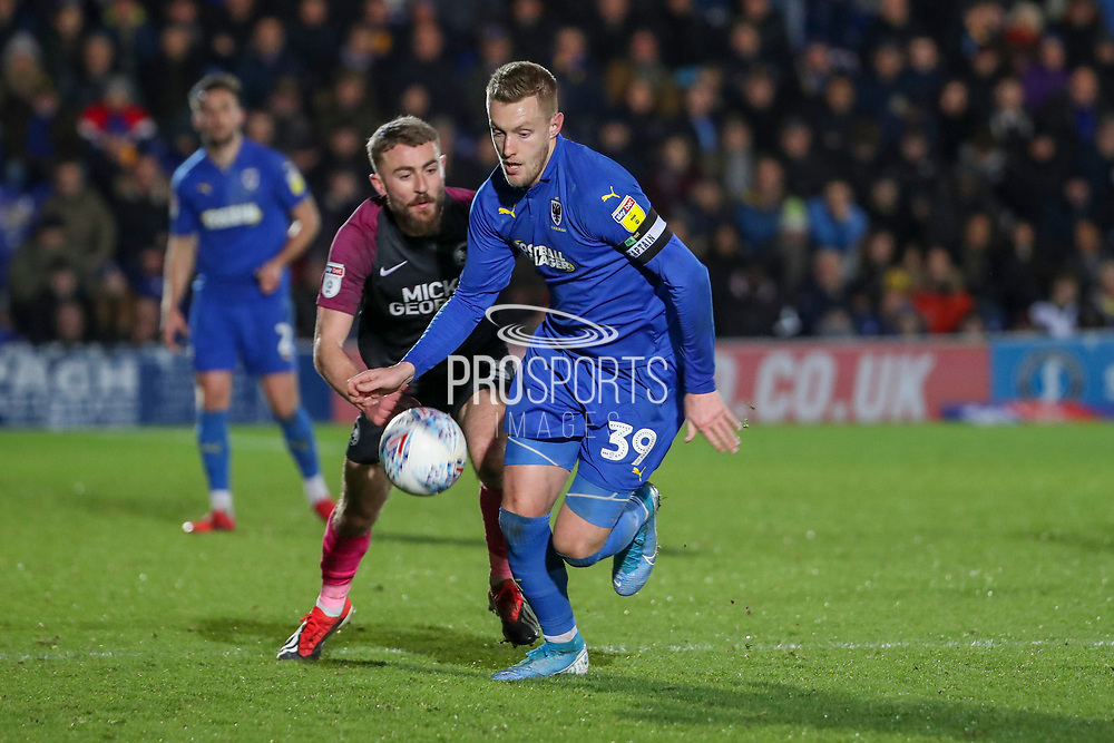 AFC Wimbledon striker Joe Pigott (39) dribbling past Peterborough United defender Dan Butler (03) during the EFL Sky Bet League 1 match between AFC Wimbledon and Peterborough United at the Cherry Red Records Stadium, Kingston, England on 18 January 2020.