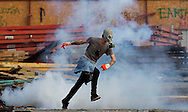 A protestor run through tear gas during clashes at Taksim Square Istanbul, Turkey on 11 June 2013.   Demonstrations against the Islamic-conservative government of Prime Minister Recep Tayyip Erdogan began on 31 May when a police crackdown against a peaceful sit-in staged by environmentalists angered over a development project in Istanbul escalated into larger battles between law enforcement and demonstrators.