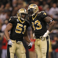 16 January 2010:  New Orleans Saints linebacker Jonathan Vilma (51) talks with defensive end Bobby McCray (93) during a 45-14 win by the New Orleans Saints over the Arizona Cardinals in a 2010 NFC Divisional Playoff game at the Louisiana Superdome in New Orleans, Louisiana.