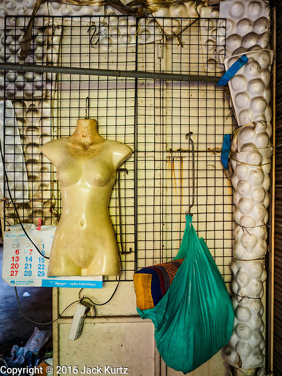 05 JANUARY 2016 - BANGKOK, THAILAND:          A mannequin left behind in the closed Bang Chak Market. The market closed permanently on January 4, 2016. The Bang Chak Market served the community around Sois 91-97 on Sukhumvit Road in the Bangkok suburbs. Bangkok city authorities put up notices in late November that the market would be closed by January 1, 2016 and redevelopment would start shortly after that. Market vendors said condominiums are being built on the land.                   PHOTO BY JACK KURTZ