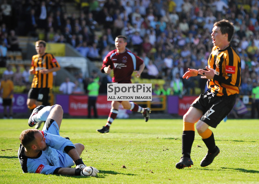 Brian Young (stripes, 7, right) has a great chance to equalise but blasts it over the bar..Auchinleck Talbot v Shotts Bon Accord, Emirates Junior Cup Final,  Sunday 27th May 2012..ALEX TODD | STOCKPIX.EU