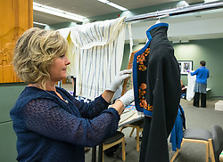 Trained professionals and volunteers from Registrars to the Rescue (R2R), an initiative of the Washington Museum Association (WaMa), work on new storage of the clothing collection of the Scandinavian Cultural Center at PLU  Wednesday, June. 22, 2016. (Photo: John Froschauer/PLU)