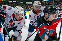 KELOWNA, BC - OCTOBER 12: Michael Farren #16 of the Kelowna Rockets checks Connor Zary #18 and Zane Franklin #16 of the Kamloops Blazers at the boards in front of the bench during second period at Prospera Place on October 12, 2019 in Kelowna, Canada. (Photo by Marissa Baecker/Shoot the Breeze)