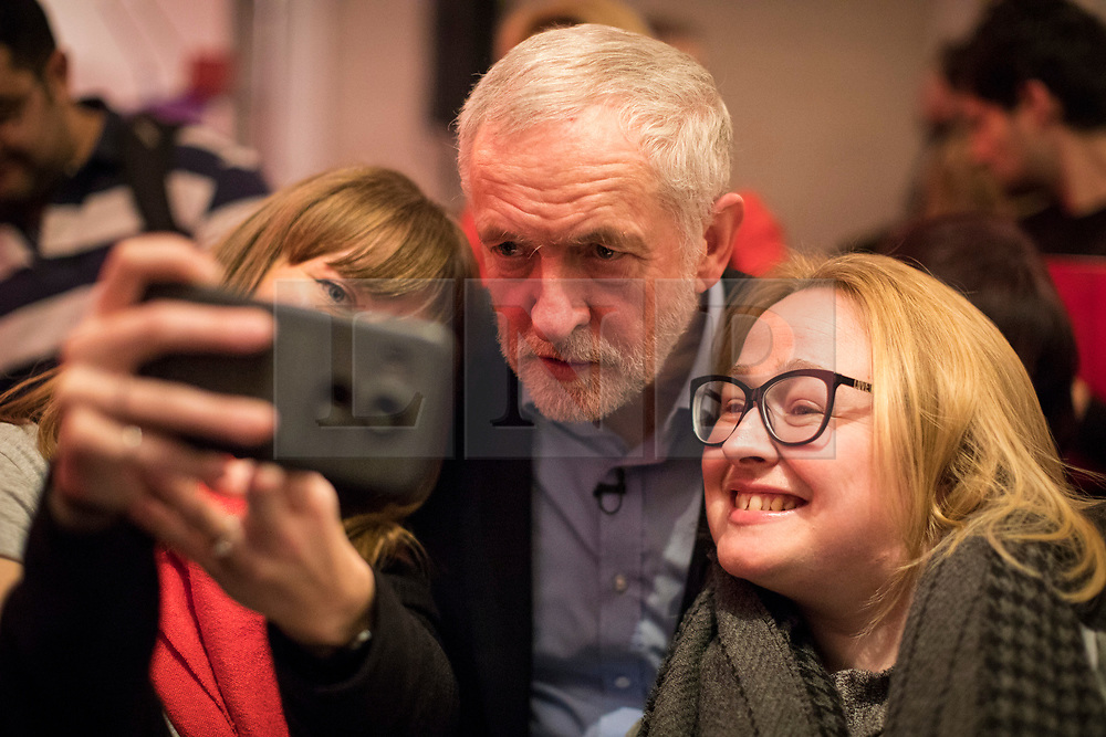 © Licensed to London News Pictures. 10/02/2018. London, UK. Labour Party Leader Jeremy Corbyn poses for a selfie with supporters at a Labour Party conference on alternative models of ownership following the collapse of construction firm Carillion and the termination of the East Coast rail franchise. Photo credit: Rob Pinney/LNP