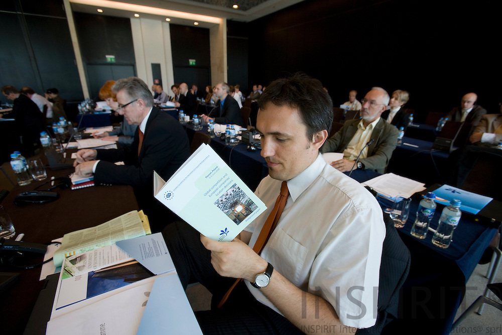 POZNAN - POLAND - 4 JUNE 2008 -- Conference on global competition and European companies' location decisions. Man reading the information material from Eurofound. Photo: Erik Luntang/INSPIRIT Photo