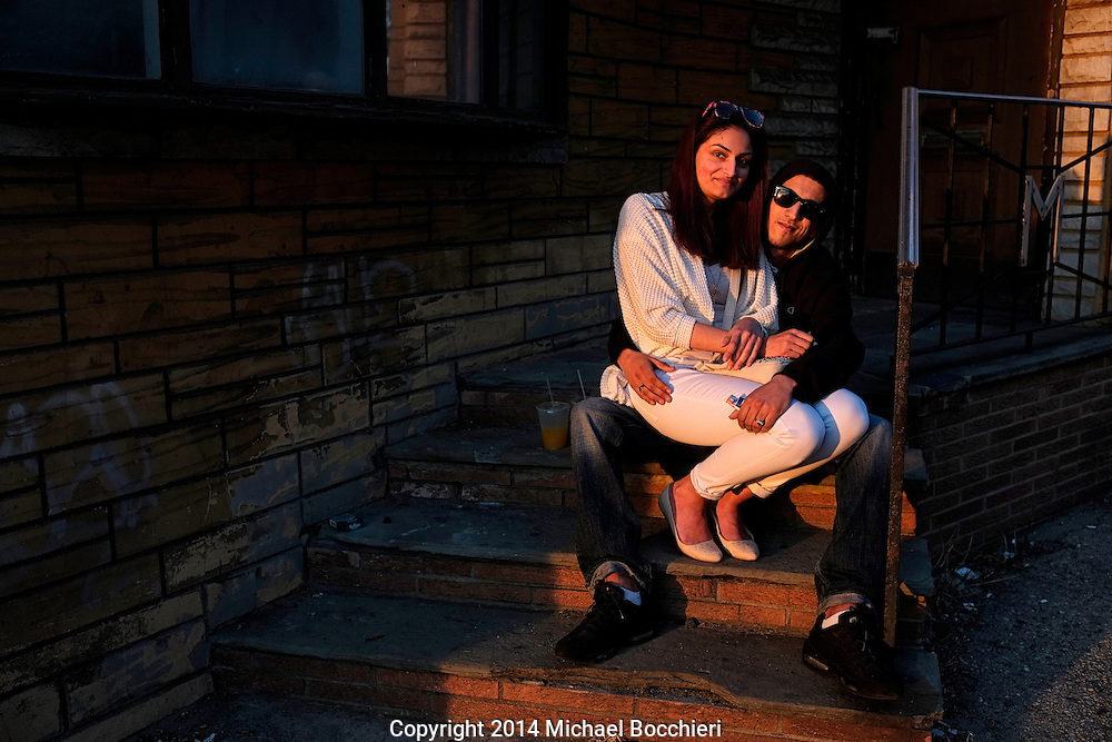 HOBOKEN, NJ - April 12:  Rawen Messai and her boyfriend, both from Jersey City pose on steps on April 12, 2014 in HOBOKEN, NJ.  (Photo by Michael Bocchieri/Bocchieri Archive)