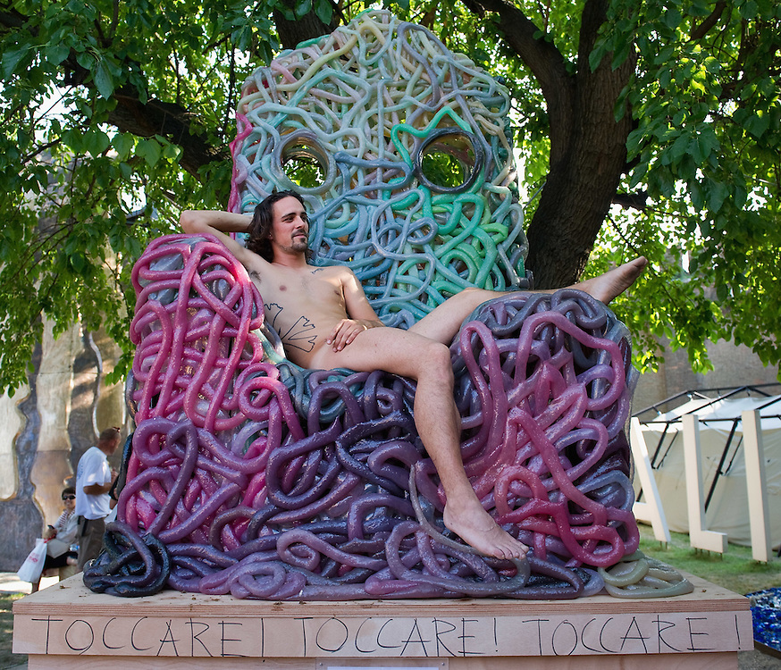 VENICE, ITALY - JUNE 02:    (EDITORS NOTE: Image contains nudity.) Massimo Cemolani sits naked on a chair by Gaetano Pesce at the Italian Pavillion on June 2, 2011 in Venice, Italy. This year's Biennale is the 54th edition and will run from June 4th until 27 November.