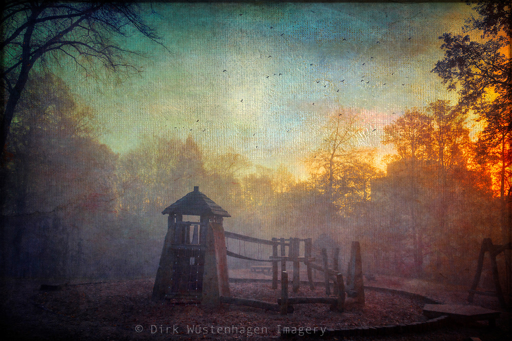 Morning sun and fog on a playground on a fall morning. Texturized photograph.<br />
