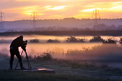 © Licensed to London News Pictures. 26/09/2018<br /> GRAVESEND, UK.<br /> Early morning cameraman filming the misty view.<br /> Autumn sunrise this morning along the banks of the River Thames from Saxon Shore Way, Gravesend.<br /> Photo credit: Grant Falvey/LNP