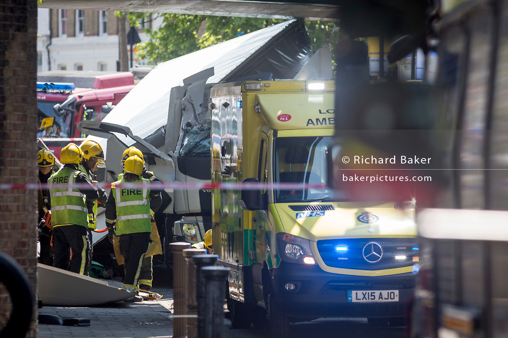 Emergency services attend to an incident at Loughborough Junction where a lorry crashed into one of the railway bridges - a main transport route for commuters into the City, on 8th May 2018, in south London, England. One person was injured.