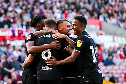 Jack Hunt of Bristol City celebrates with his teammates after his cross forces a Stoke City own goal to make it 1-2 - Rogan/JMP - 14/09/2019 - Bet365 Stadium - Stoke, England - Stoke City v Bristol City - Sky Bet Championship.