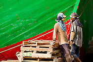 Dock workers taking a break beside a ship docked at Sunda Kelapa (the old port) in Jakarta, Indonesia.