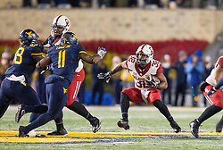 Nov 19, 2016; Morgantown, WV, USA; Oklahoma Sooners running back Samaje Perine (32) runs the ball during the second quarter against the West Virginia Mountaineers at Milan Puskar Stadium. Mandatory Credit: Ben Queen-USA TODAY Sports