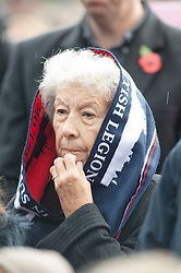© Licensed to London News Pictures. 11/11/2018. Orpington, UK.Lady wearing a British Legion scarf to keep the rain off during the service. Ex-transport minister and MP for Orpington Jo Johnson attending the Remembrance day service at Orpington war memorial to mark one hundred years since the end of the first world war.Photo credit: Grant Falvey/LNP