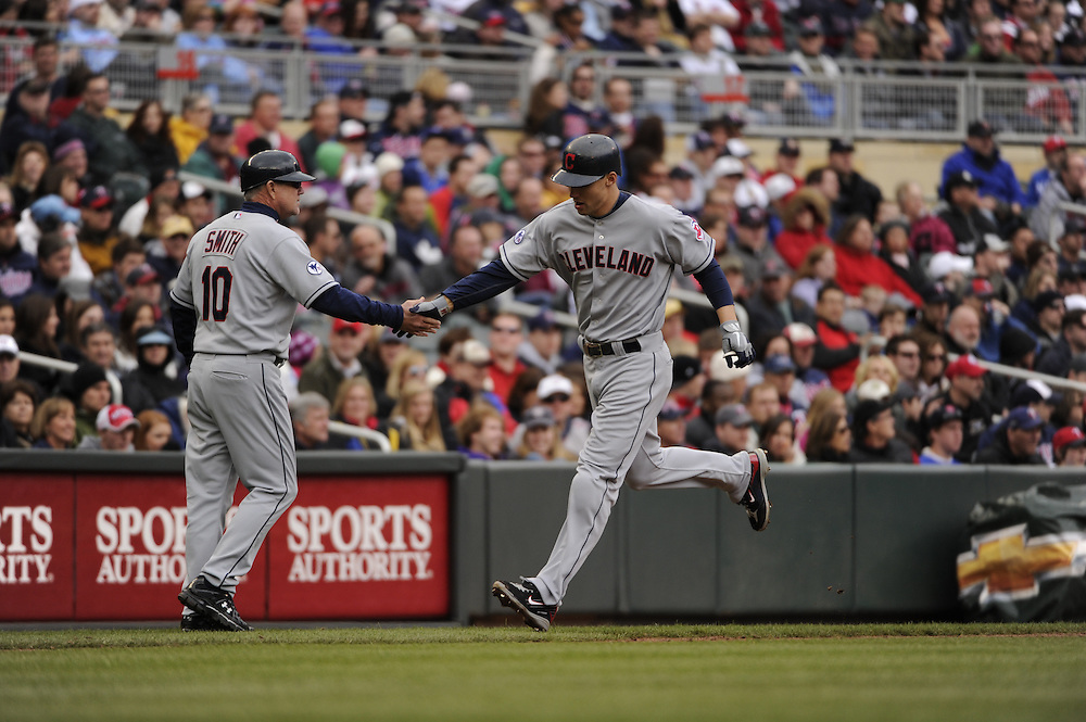 MINNEAPOLIS - APRIL 23:  Grady Sizemore #24 is greeted by third base coach Steve Smith #10 of the Cleveland Indians after hitting a two-run home run in the eighth inning against the Minnesota Twins on April 23, 2011 at Target Field in Minneapolis, Minnesota.  The Twins defeated the Indians 10-3.  (Photo by Ron Vesely)  Subject:  Grady Sizemore;Steve Smith