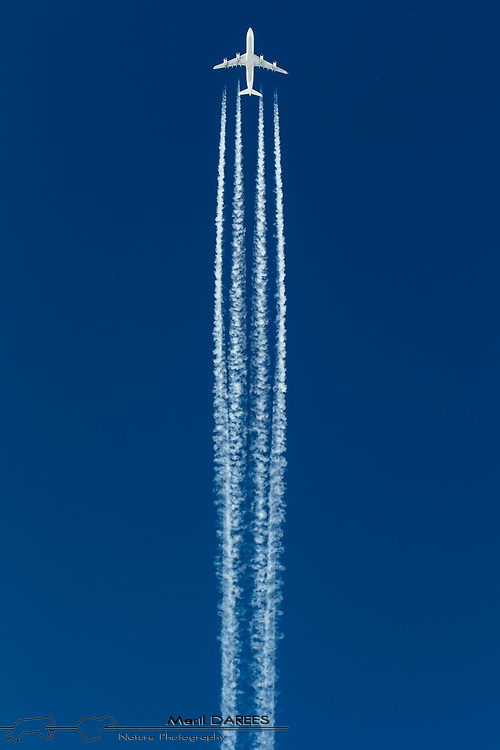 An airbus 340 with his condensation trails.