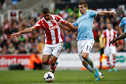 Manchester City's Matija Nastasic and Stoke City's Jonathan Walters battle for the ball - Photo mandatory by-line: Matt Bunn/JMP - Tel: Mobile: 07966 386802 14/09/2013 - SPORT - FOOTBALL -  Britannia Stadium - Stoke-On-Trent - Stoke City V Manchester City - Barclays Premier League