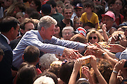 President Bill Clinton shakes hands with supporters during a campaign stop for his re-election August 27, 1996 in Wayandotte, MI