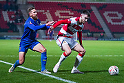 Doncaster Rovers midfielder Ben Whiteman (8) and AFC Wimbledon midfielder Scott Wagstaff (7) during the The FA Cup match between Doncaster Rovers and AFC Wimbledon at the Keepmoat Stadium, Doncaster, England on 19 November 2019.
