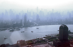 CHINA SHANGHAI MAY99 - The Shanghai skyline, as seen from the Pudong Hyatt hotel, is covered in smog and haze generated by the countless motorised vehicles polluting the air...jre/Photo by Jiri Rezac..© Jiri Rezac 1999..Contact: +44 (0) 7050 110 417.Mobile:  +44 (0) 7801 337 683.Office:  +44 (0) 20 8968 9635..Email:   jiri@jirirezac.com.Web:    www.jirirezac.com..© All images Jiri Rezac 1999 - All rights reserved.