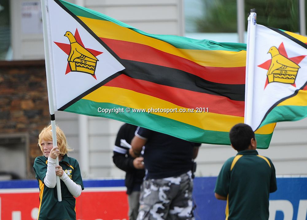 Flag bearers at the 2nd ODI cricket match between New Zealand and Zimbabwe at Cobham Oval in Whangarei, Monday 6 February 2012. Napier, New Zealand. Photo: Andrew Cornaga/Photosport.co.nz