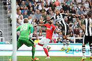 Newcastle United striker Yoan Gouffran (20) and Brighton & Hove Albion's full back Bruno Saltor (Captain) (2) during the EFL Sky Bet Championship match between Newcastle United and Brighton and Hove Albion at St. James's Park, Newcastle, England on 27 August 2016.