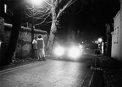 Prostitutes standing in street with kerb crawler,