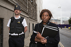 © licensed to London News Pictures. London, UK 04/10/2013. Constance Briscoe (right), the barrister and part-time judge who is accused of perverting the course of justice in connection with the Chris Huhne case, leaving the Old Bailey court in central London after the Plea & Case Management Hearing (PCMH). Photo credit: Tolga Akmen/LNP