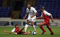 Photo: Paul Thomas.<br /> Bolton Wanderers v Braga. UEFA Cup. 25/10/2007.<br /> <br /> Nicolas Anelka (C) of Bolton is tackled by Wender (L). *** Local Caption *** *** UK ONLY ***