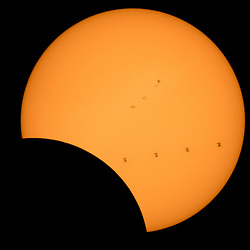 This composite image, made from 4 frames, shows the International Space Station, with a crew of six onboard, as it transits the Sun at roughly five miles per second during a partial solar eclipse, Monday, Aug. 21, 2017 from , Northern Cascades National Park in Washington. Onboard as part of Expedition 52 are: NASA astronauts Peggy Whitson, Jack Fischer, and Randy Bresnik; Russian cosmonauts Fyodor Yurchikhin and Sergey Ryazanskiy; and ESA (European Space Agency) astronaut Paolo Nespoli. A total solar eclipse swept across a narrow portion of the contiguous United States from Lincoln Beach, Oregon to Charleston, South Carolina. A partial solar eclipse was visible across the entire North American continent along with parts of South America, Africa, and Europe.  Photo Credit: (NASA/Bill Ingalls)