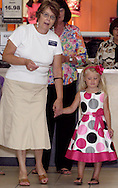 Linda Bodey (left) helps a model during a fashion show at the Elder Beerman store in the Dayton Mall, Saturday, August 14. 2010..