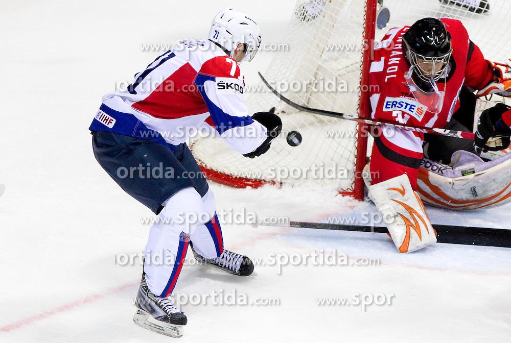 Bostjan Golicic of Slovenia vs Fabian Weinhandl of Austria during ice-hockey match between Austria and Slovenia of Group G in Relegation Round of IIHF 2011 World Championship Slovakia, on May 7, 2011 in Orange Arena, Bratislava, Slovakia. (Photo By Vid Ponikvar / Sportida.com)