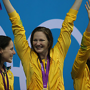 The Australian team of Alicia Coutts, Cate Campbell,  Melanie Schlanger, Elmslie Brittany, winning the gold medal in the women's 4 x 100m freestyle relay final during the swimming finals at the Aquatic Centre at Olympic Park, Stratford during the London 2012 Olympic games. London, UK. 28th July 2012. Photo Tim Clayton