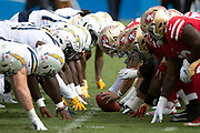 The San Francisco 49ers offensive line gets set to snap the ball at the line of scrimmage opposite the Los Angeles Chargers defensive line during the NFL week 4 regular season football game against the Los Angeles Chargers on Sunday, Sept. 30, 2018 in Carson, Calif. The Chargers won the game 29-27. (©Paul Anthony Spinelli)