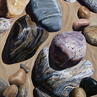 The striped patterns within these beach stones is gently repeated in the sand where retreating waves have left their mark. <br />