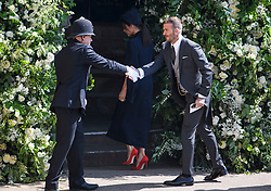© Licensed to London News Pictures. 19/05/2018. London, UK. DAVID AND VICTORIA BECKHAM. Guests arrive at The wedding of Prince Harry, The Duke of Sussex to Meghan Markle, The Duchess of Sussex, at St George's Chapel in Windsor. Photo credit: Ben Cawthra/LNP