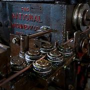 Steel rod-bending operation in machine shop.