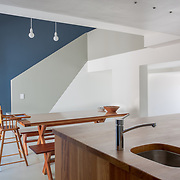 Residential dining room and kitchen interior.<br />