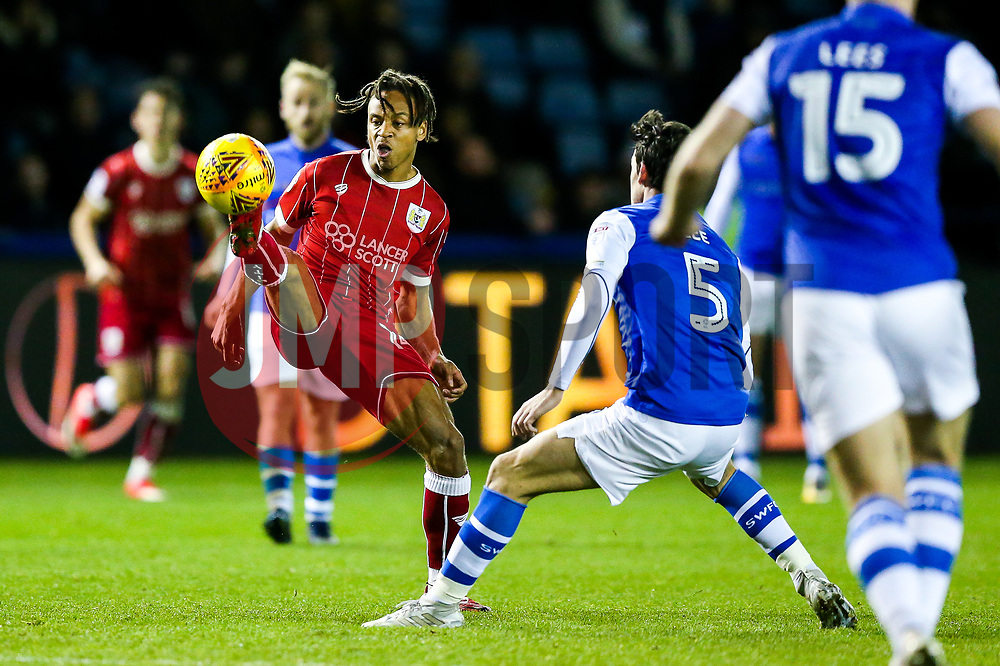 Bobby Reid of Bristol City is challenged by Kieran Lee of Sheffield Wednesday - Rogan/JMP - 18/11/2017 - Hillsborough Stadium - Sheffield, England - Sheffield Wednesday v Bristol City - Sky Bet Championship.