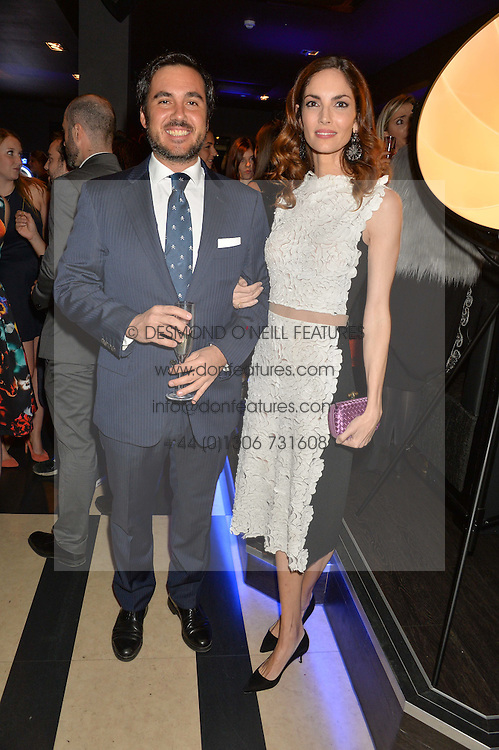 EDUARDO SANCHEZ and EUGENIA SILVA at a party to celebrate the 1st anniversary of Hello! Fashion Monthly magazine held at Charlie, 15 Berkeley Street, London on 14th October 2015.