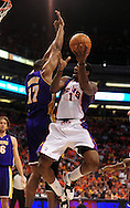 May 23, 2010; Phoenix, AZ, USA; Phoenix Suns forward Amare Stoudemire (1) puts up a basket against Los Angeles Lakers center Andrew Bynum (17) during the first half in game three of the western conference finals in the 2010 NBA Playoffs at US Airways Center.  Mandatory Credit: Jennifer Stewart-US PRESSWIRE