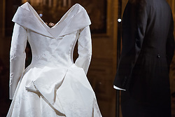 Windsor, UK. 28th February, 2019. A detail of the low back of HRH Princess Eugenie's wedding dress, created by Peter Pilotto and Christopher De Vos of the British-based label Peter Pilotto, which was specifically requested by the Princess to display the scar from surgery she underwent aged 12 to correct scoliosis. The dress and Mr Jack Brooksbank's morning suit made by tailors at Huntsman on Savile Row, will go on display with other items from their wedding outfits at Windsor Castle in a special exhibition named 'A Royal Wedding: HRH Princess Eugenie and Mr Jack Brooksbank' from 1st March to 22nd April. The other items include the Greville Emerald Kokoshnik Tiara, on public display for the first time, two diamond wheat-ear brooches, diamond and emerald drop earrings, Princess Eugenie's evening gown, HRH Princess Beatrice's blue dress by the London-based couture house Ralph & Russo and headpiece by British milliner Sarah Cant and a bridesmaid and pageboy outfit by London-based children's designer Amaia Kids.