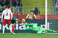 Chorzow, Poland - 2018 March 27: Goalkeeper Lukasz Skorupski from Poland saves while Poland v South Korea International Friendly Soccer match at Stadion Slaski on March 27, 2018 in Chorzow, Poland.<br /> <br /> Mandatory credit:<br /> Photo by © Adam Nurkiewicz / Mediasport<br /> <br /> Adam Nurkiewicz declares that he has no rights to the image of people at the photographs of his authorship.<br /> <br /> Picture also available in RAW (NEF) or TIFF format on special request.<br /> <br /> Any editorial, commercial or promotional use requires written permission from the author of image.