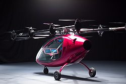 """A new automatic passenger drone that could revolutionize the daily commute has completed its first manned flight. California-based company Passenger Drone launched the red aerial vehicle, which has a top speed of 45mph, following months of rigorous testing. Complete with a touch-screen, the drone can be flown manually or at the touch of a button select a destination and the air vehicle takes over. It carries up to two people, is equipped with 16 electric engines and has a flight range of up to 25 minutes. Flight testing of the vertical take off and landing (VTOL) craft started in May before the first manned flight took place in August, footage of which was released this week as part of the official launch. A company spokesman explained: """"The social and economic benefits of such a vehicle are numerous. """"In cities around the world, traffic congestion costs commuters millions of hours every year and billions of dollars in lost productivity."""" According to Passenger Drone, the average travel time to work in the United States is 25.4 minute, representing almost an hour every day. The company adds that the total cost of congestion to all drivers in the U.S. in 2016, including environmental costs, was $300 billion. The spokesman added: """"On-demand aviation and manned drones has the potential to radically transform how we get from place to place, and to restore precious lost family and personal time to commuters worldwide. """"Overall, the lower cost and improved flexibility provided by aerial drone technology may afford compelling solutions for individuals, businesses or governments worldwide."""". 03 Oct 2017 Pictured: California-based company Passenger Drone has launched a new automatic aerial vehicle that could revolutionize the daily commute. Photo credit: Passenger Drone/ MEGA TheMegaAgency.com +1 888 505 6342"""