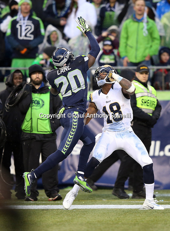 Seattle Seahawks cornerback Jeremy Lane (20) jumps and breaks up a deep pass intended for St. Louis Rams wide receiver Kenny Britt (18) during the 2015 NFL week 16 regular season football game against the St. Louis Rams on Sunday, Dec. 27, 2015 in Seattle. The Rams won the game 23-17. (©Paul Anthony Spinelli)