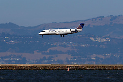 Bombardier CRJ-200LR (N593ML) operated by SkyWest Airlines for United Express landing at San Francisco International Airport (KSFO), San Francisco, California, United States of America
