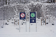 Supermarket signs after unusually heavy snow fall in South London.