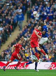 LONDON, ENGLAND - Saturday, April 14, 2012: Liverpool's Andy Carroll and Everton's Sylvain Distin during the FA Cup Semi-Final match at Wembley. (Pic by David Rawcliffe/Propaganda)
