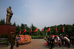 Chinese visitors bow in front of Mao Zedong's giant statue on Mao Zedong Bronze Statue Square in Shaoshan, Hunan Province in central China, 28 April 2016. Shaoshan is the hometown of former Communist leader Mao Zedong, popularly known as Chairman Mao. Thousands of visitors descend on this small Chinese town burrowed in the hills of Central China's Hunan province to pay homage to the great helmsman everyday. It is one of the core sites of the 'Red Tourism' industry, where communist party cadres and ordinary Chinese tourists alike seek to relive the experiences and rekindle the spirit of the revolutionaries.